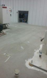 Industrial machine shop floor before refinishing